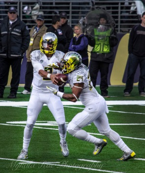 Heisman favorite #8 Marcus Mariota passes off to Oregon native, #24 Thomas Tyner. Tyner graduated from Aloha highschool last year and has already made it clear he's here to play. He carried 12 passes and rushed 57 yards last weekend in Seattle. Not bad for a red shirt freshman!